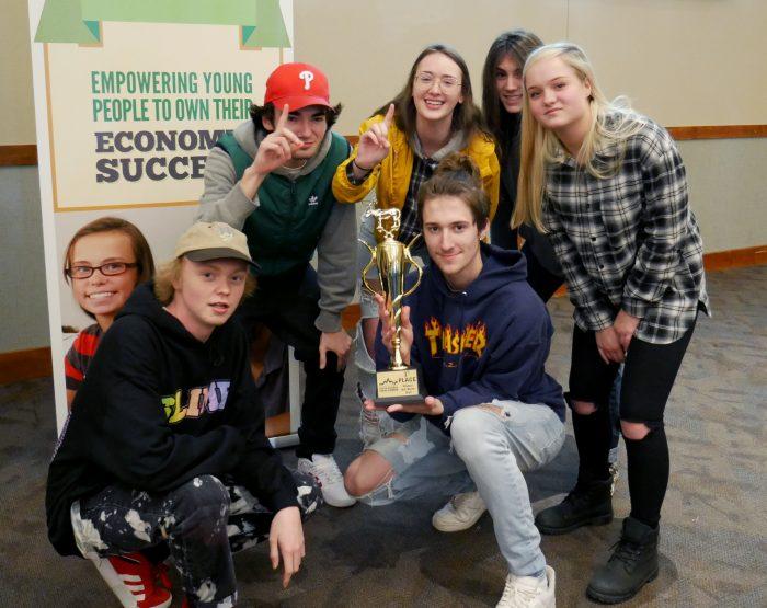 Centennial High School students with trophy at Junior Achievement Stock Market Challenge