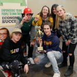Centennial High School students with trophy at Junior Achievement Stock Market Challenge