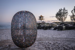 Superegg Coffee Capsule Sculpture at dusk