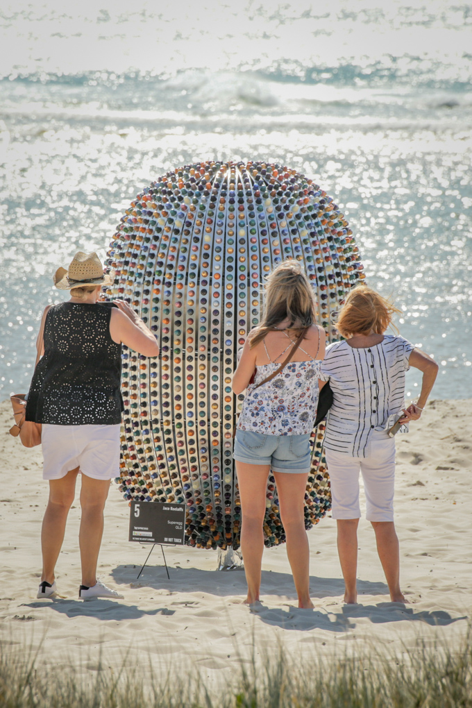 Superegg Coffee Capsule Sculpture with visitors interacting.