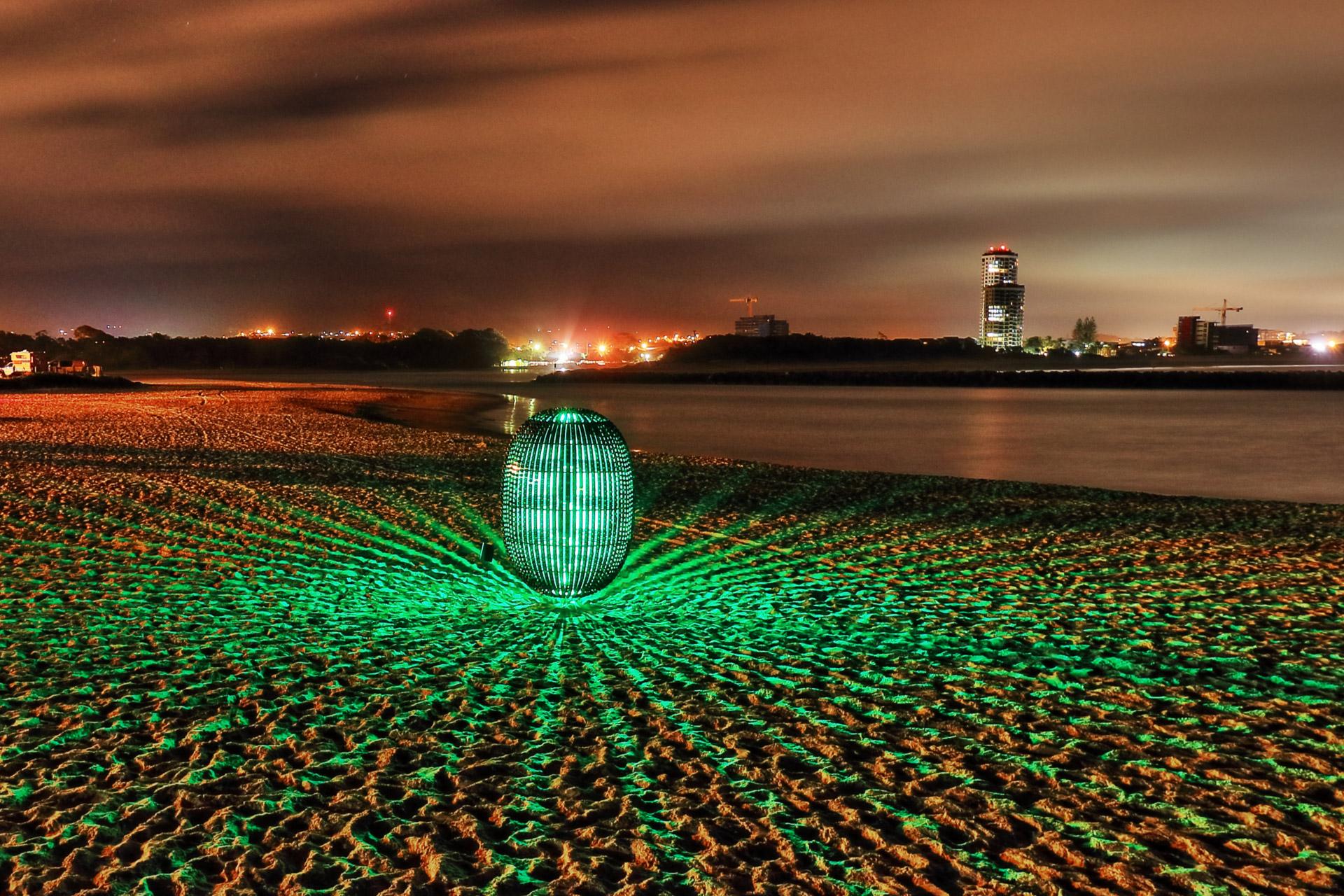 Superegg Coffee Capsule Sculpture at night
