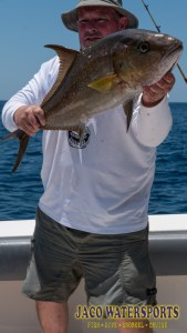 Client holding a greater amberjack