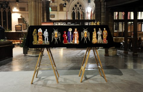King Richard III reburial reinternment. The coffin drapped covered by the Funeral Pall standing inside Leicester Cathedral.