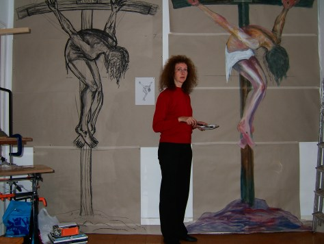 Jacquie in her studio with life size studies for the Plymouth Crucifixion.