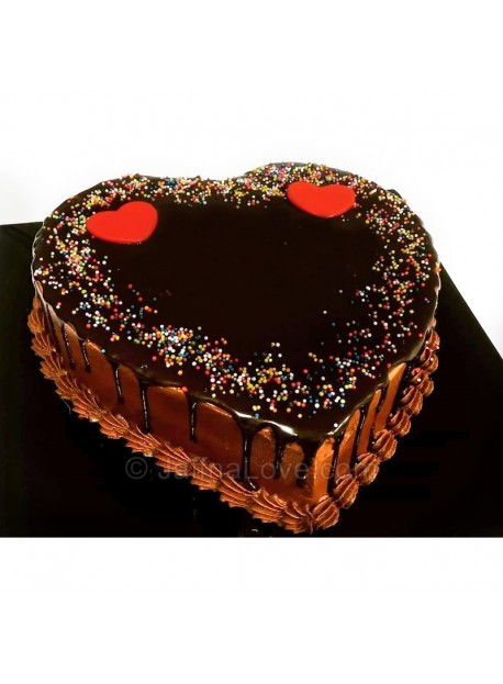 To decorate a heart shaped cake, you can cover it with fondant or vanilla or chocolate icing and top it with cherries, strawberries and many more goodies. Heart Shaped Chocolate Cake Jaffnalove Com