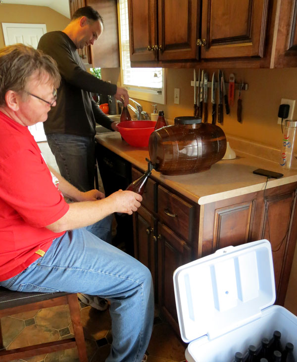 Mark and Nick bottle home brewed beer