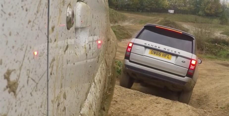 Suzuki Jomy following a Range Rover off-road.