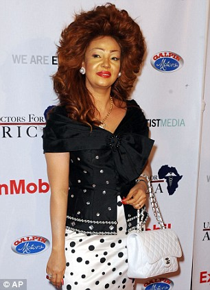 Cameroon...oh!! sweet Cameroon..need i say more about Chantal Biya, Cameroon First Lady. If you are trying to show your friends Africa is not always about Lions, then try not to google her. No offense to Cameroonians, but none can deny that hair..i personally feel sorry for her neck carrying that much weight. Yes, she does make a statement, and not a good one. Her polka dotted outfit proves it, and more. And to think she is known for spending alot of money on outfits. You cant help but notice where it goes. On the other though, i am feeling her chanel bag, if only she didnt place it near that cow skin..err, i mean skirt.