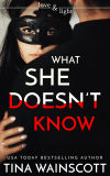 What She Doesn't Know Cover Art