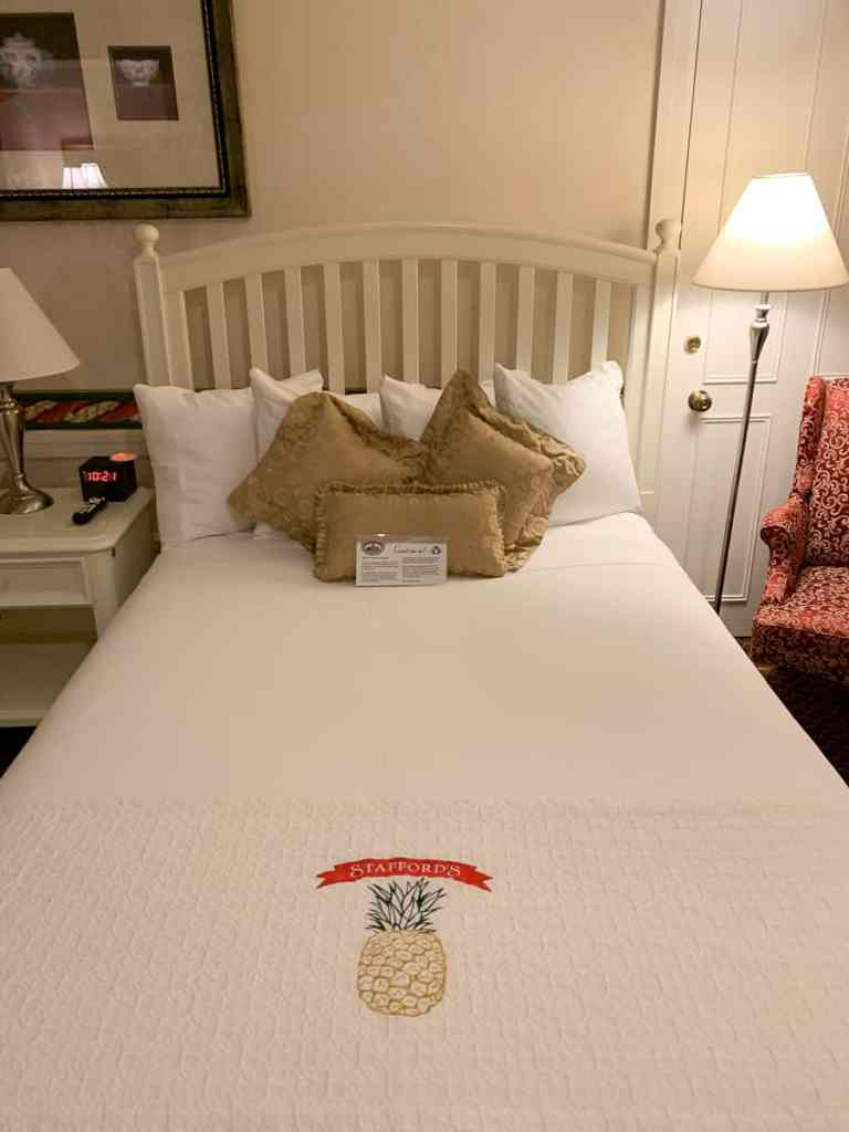 Cozy Bed at Stafford's Perry Hotel in Petoskey, Michigan.