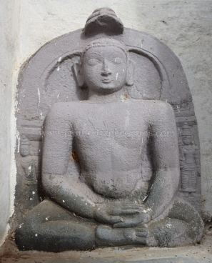 A Tirthankara in Padmasana in the premises of Parshwanath Temple