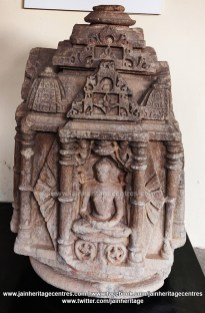 Chaturmukha Jain Tirthankara idol with Tirthankara seated in Padmasana, 10th- 11th Century.