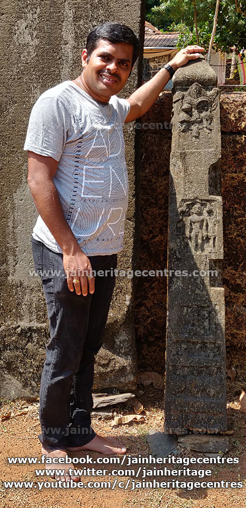Researcher Nitin in front of the Jain hero stone at Gerusoppa.