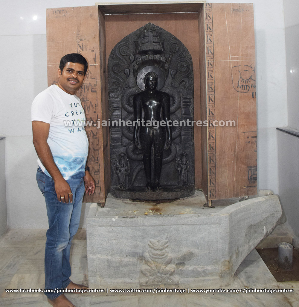 Researcher Nitin H P along with the idol of Lord Parshwanath, the main deity of Dodda Basadi.