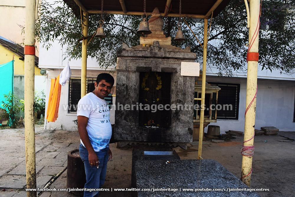 Researcher Nitin H P besides the Jattigaraya Mantapa of Dodda Basadi, Hassan.