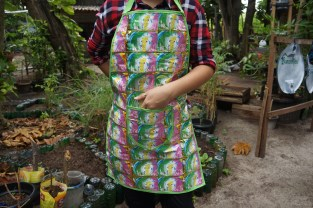 Apron made from washing detergent packaging.