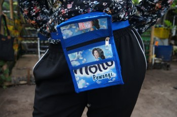 Satchel made from washing detergent packaging.