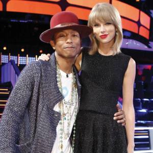 Pharrell poses with Taylor Swift The Voice