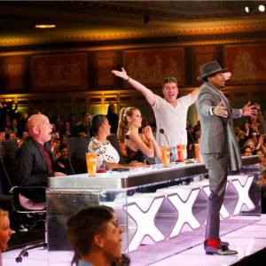 Nick Cannon presses the Golden Buzzer