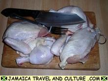 Jerk Chicken - Cutting the raw chicken
