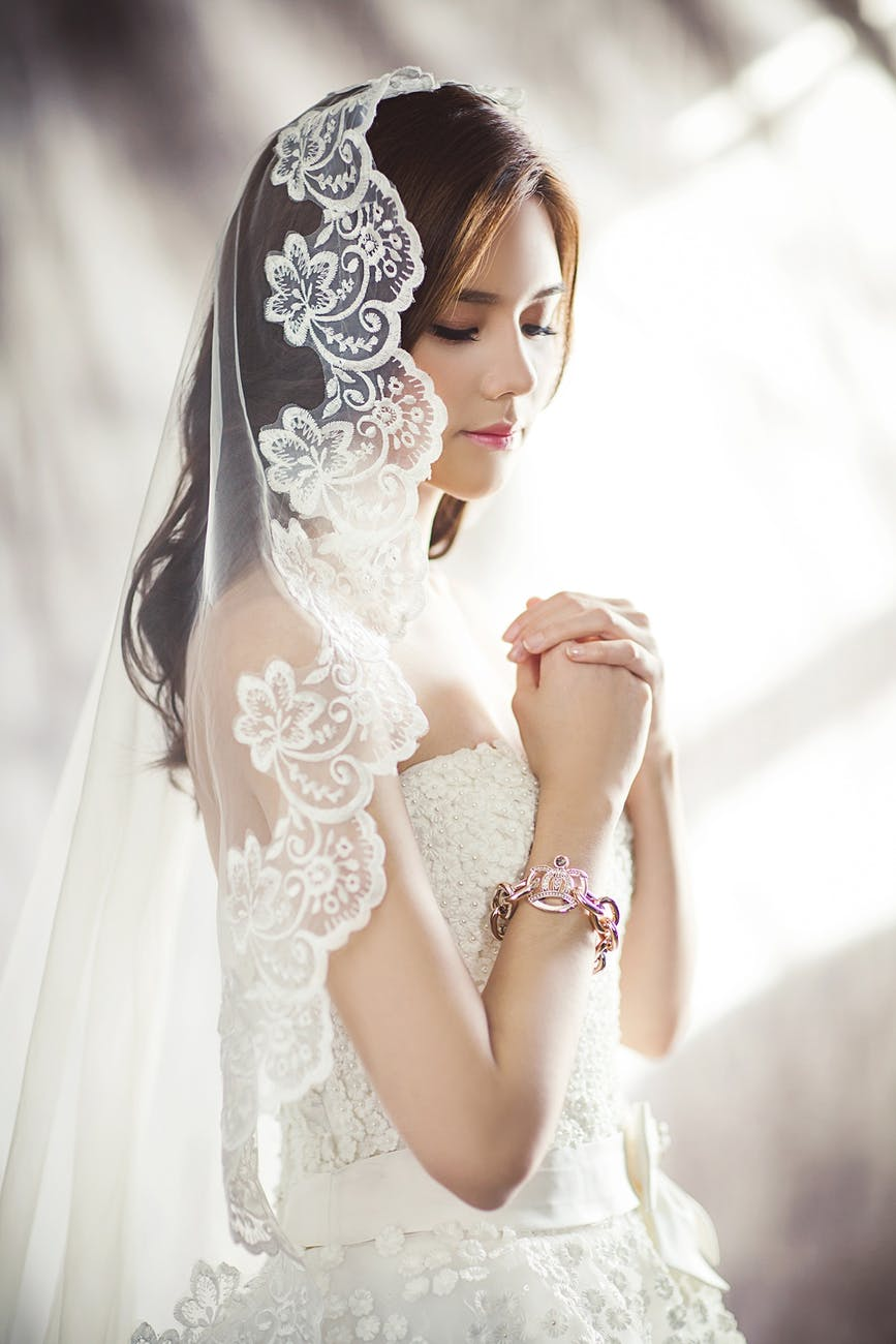 woman in white bridal gown meditating