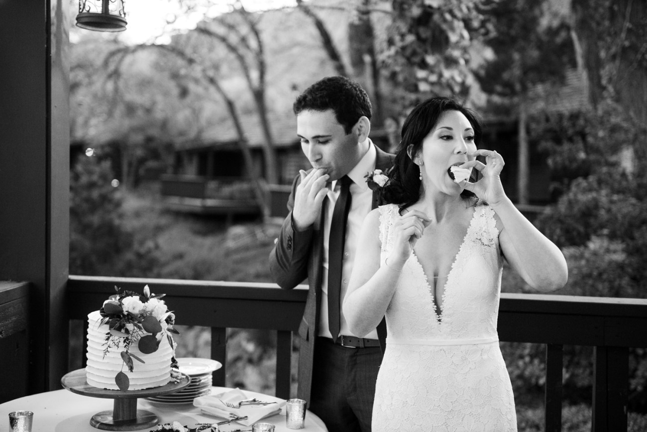 black and white wedding cake cutting