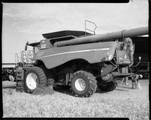John Barrett cleans a 2014 John Deere combine during wheat harvest in Altus, Oklahoma.