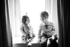 A brother and sister laughing together