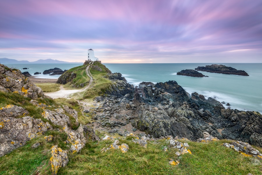 Tŵr Mawr lighthouse on Ynys Llanddwyn on Angelsey in North Wales at sunset