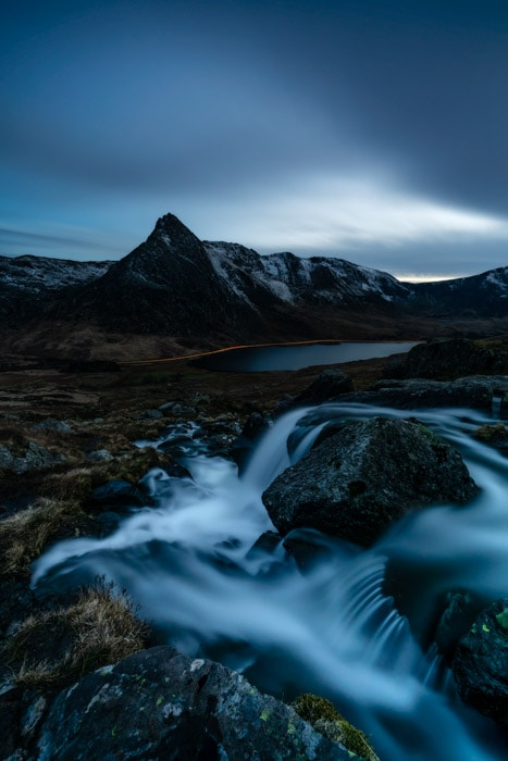 Tryfan in Snowdonia, North Wales, at blue hour with light trails