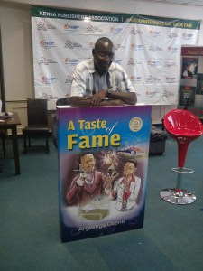 Argwings Otieno with a dummy copy of his winning book.