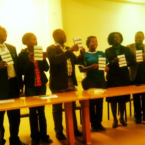 Zukiswa Wanner and members of the literature department of Moi University holds aloft a copy of the newly launched London Cape Town Joburg.