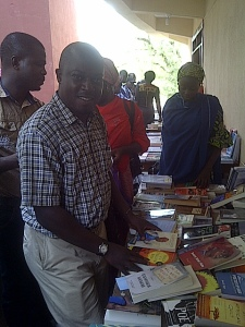 Richard Ali buying books at the Convention.