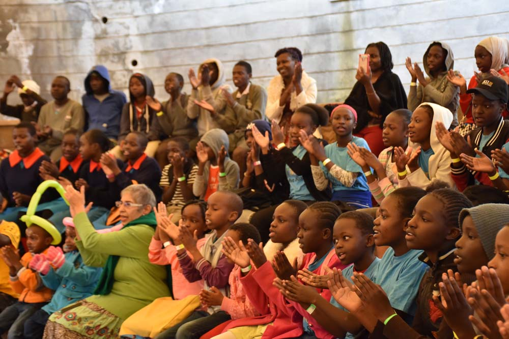 Time out: the audience participating in the story as it was shared Wangari The Storyteller.