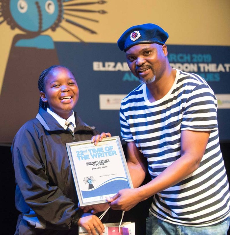 Learner gets a certificate from Niq Mhlongo
