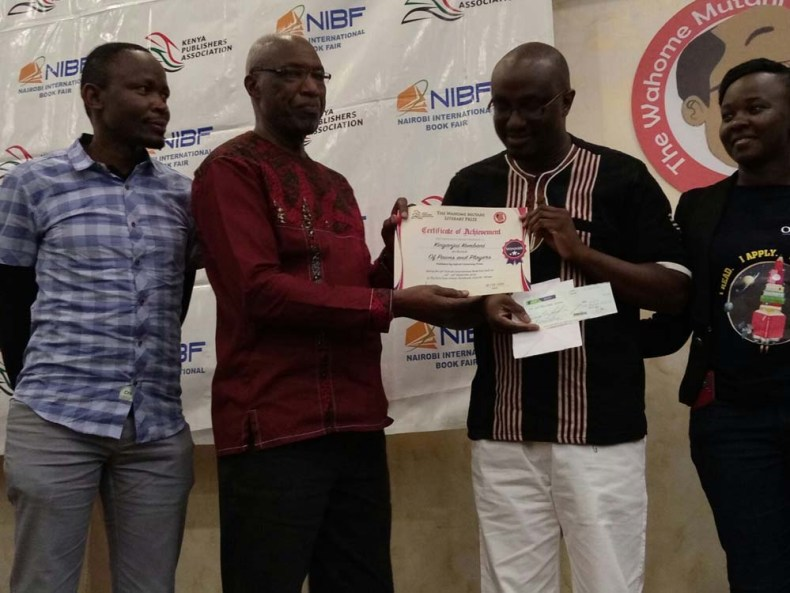 Prof Paul Wainaina hands out the Wahome Mutahi Prize 2019 to Kinyanjui Kombani