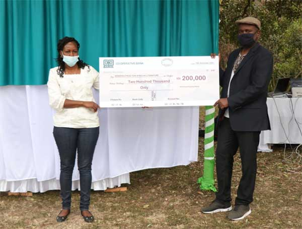 Purity hands out the sponsorship cheque to advisory board chair James Murua