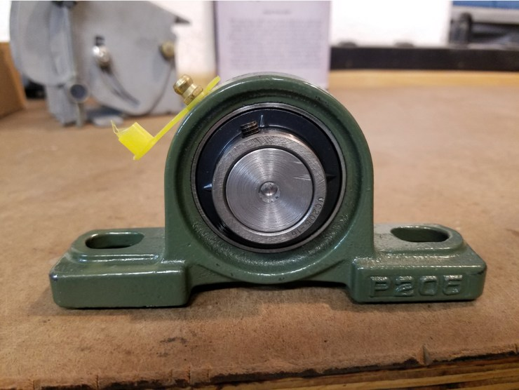 Looking at the end of the axle in the pillow block