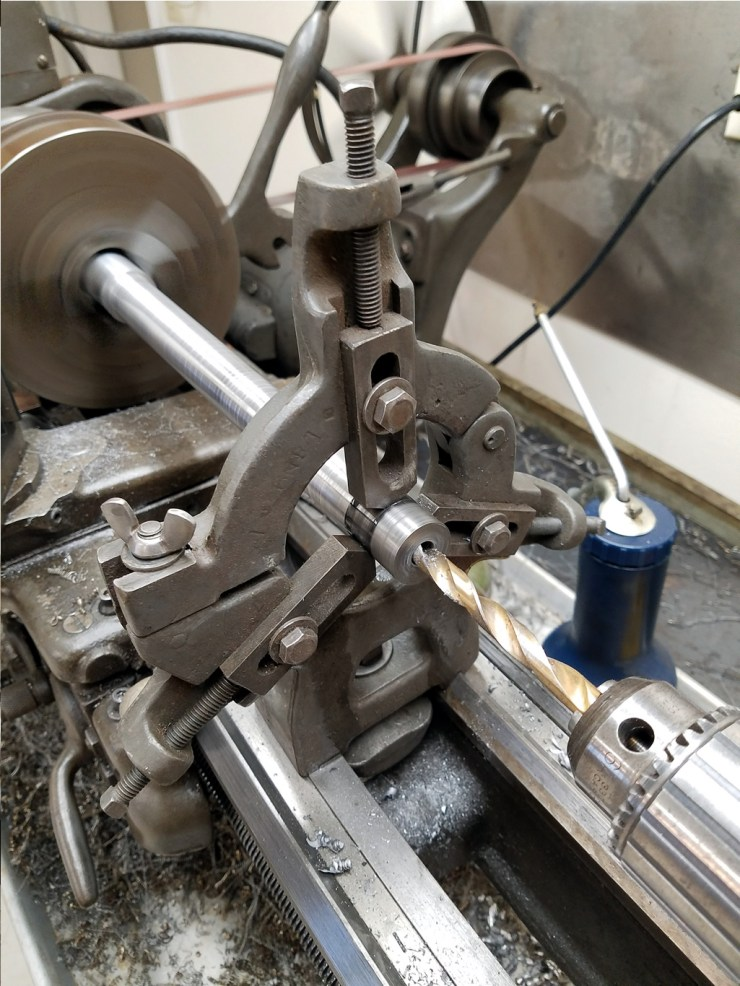 Drilling a 3.8 hole down the center of the axle to loose some weight.