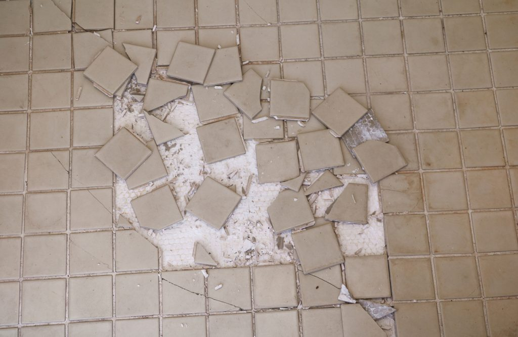 cracked tile on floors and walls