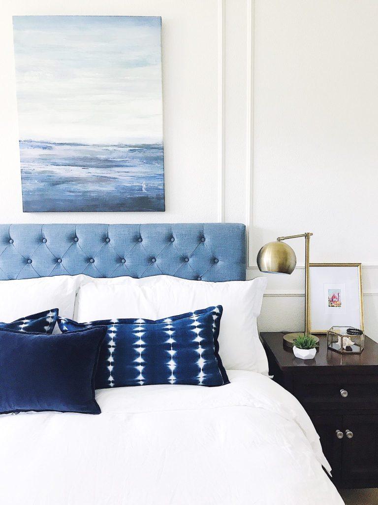 Blue and white coastal bedroom-white walls-panel molding-modern boho style-shibori pillows-refresh your home decor