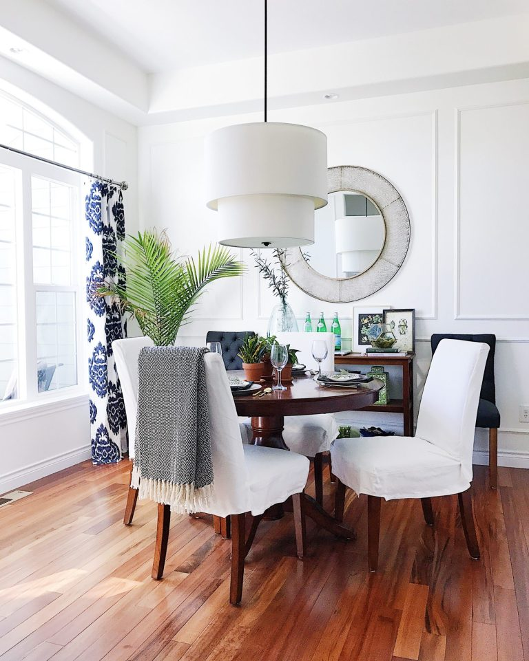 Make Your Home Feel More Cozy-dining room with modern light fixture and panel molding on walls