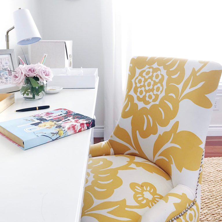 Make Your Home Feel More Cozy-home office workspace with yellow chair and pink flowers