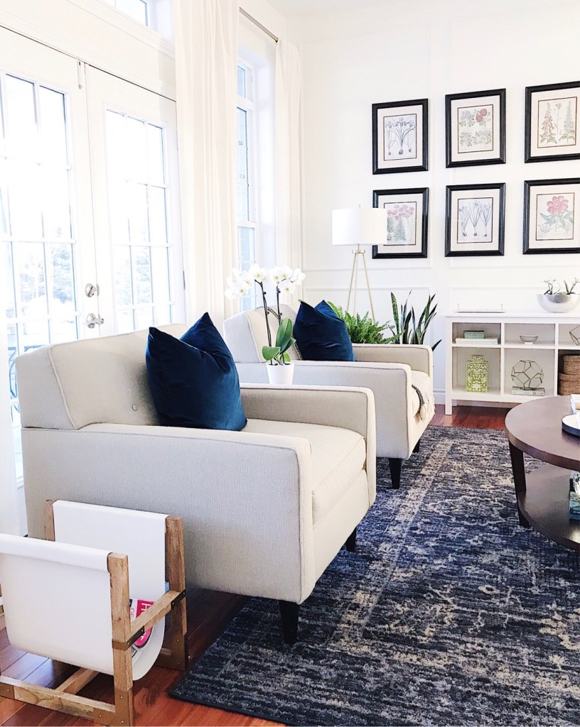 5 Tips to Declutter Your Home and Simplify Your Life-blue and white living room with gallery wall