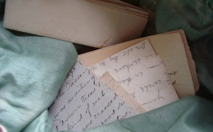 several old, handwritten letters in a loose stack
