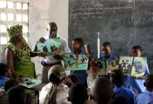JGI Education team tells school children in Republic of Congo about chimpanzees.