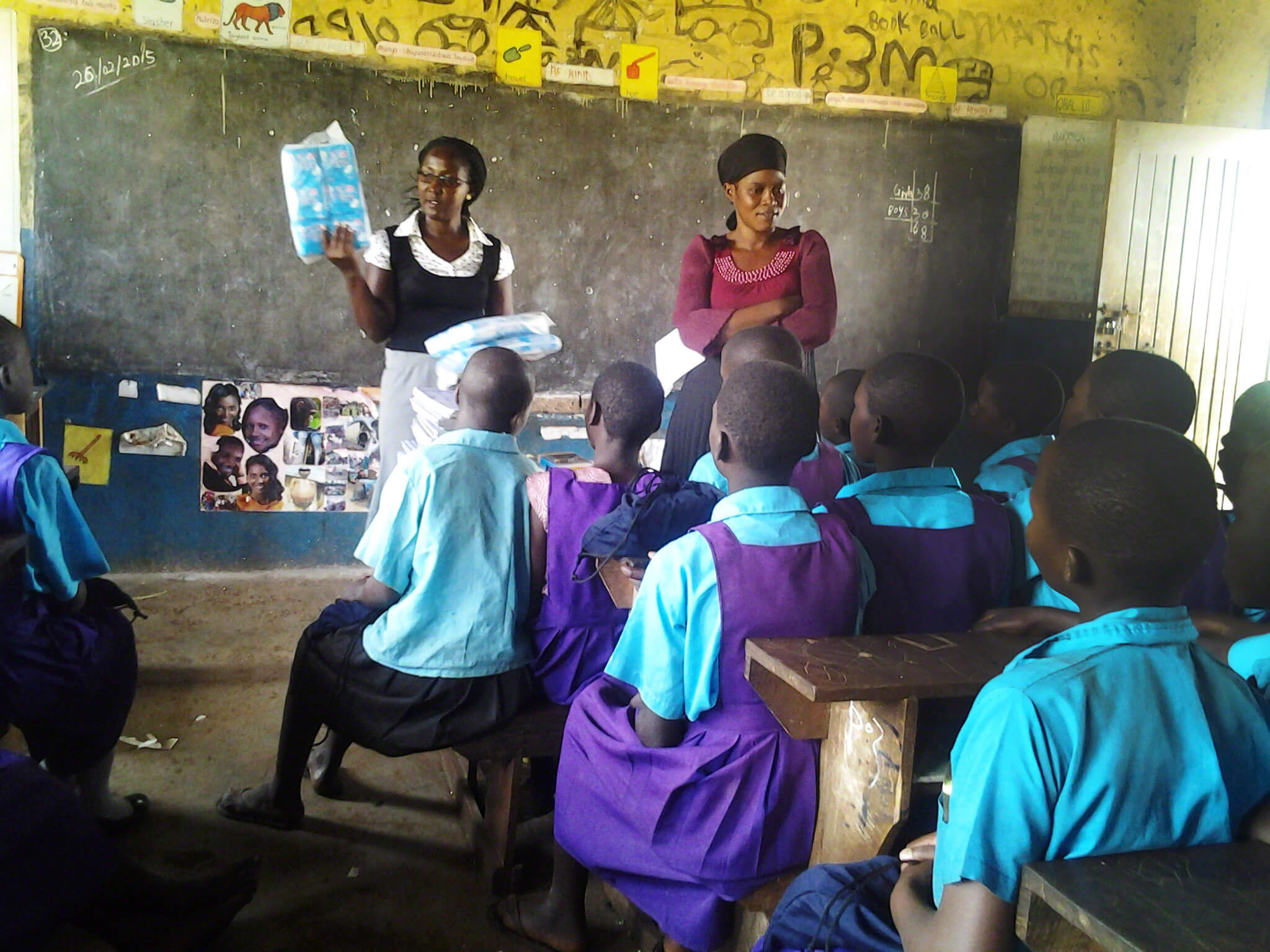 Girls learn about reproductive health through JGI Peer - Peer program in Uganda