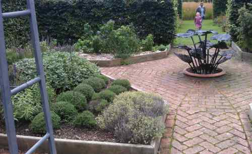 Herb beds and fountain sculpture
