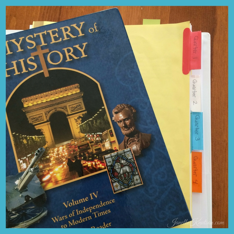 The Mystery of History student binder divided into 4 quarters