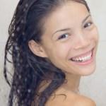 a beautiful, young girl smiling.